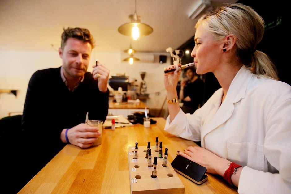 People vaping electronic cigarettes at a vape bar